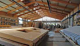 In unserem Werk fertigen wir Holzrahmenbauteile für den schlüsselfertigen Hausbau